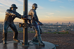 Tribute to the Roughnecks (Viajante) Tags: california city urban sculpture statue skyline sunrise dawn us unitedstates oil signalhill roughneck
