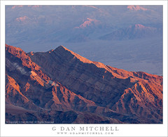 Ridge Above Tucki Wash, Dawn (G Dan Mitchell) Tags: california park morning travel blue winter light red orange usa mountain nature america sunrise print point landscape death dawn haze desert north stock scenic first atmosphere ridge wash national valley strata license geology stark range stratified gully uplift panamint tucki aguereberry