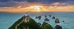 Nugget Point Lighthouse (Mike Isaak) Tags: ocean blue trees newzealand panorama orange lighthouse green nature water yellow clouds sunrise landscape photography coast solar amazing nikon rocks photographer hiking pano naturallight panoramic hike otago coastline filters epic hdr fineartphotography waterscape nuggetpoint solarpowered godlight travelphotography gnd nuggetpointlighthouse d300s mikeisaak wwwmikeisaakcom