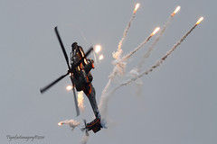 Apache show (Ross Forsyth - tigerfastimagery) Tags: netherlands chopper apache europe fighter display aircraft aviation military helicopter airforce flares nato gunship firepower 2011 ah64 luchtmachtdagen leeuwardenab