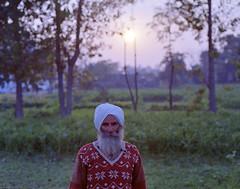 indian (Benjamin Skanke) Tags: sunset portrait india man green 120 film field fog analog vintage asia dof pentax takumar kodak bokeh medium format 24 farmer 6x7 turban sikh punjab expired portra canoscan 67 120mm 105mm 400nc