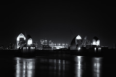 Thames Barrier, Canary Wharf and the Dome (iainsr) Tags: longexposure blackandwhite night dome canarywharf riverthames hsbc millenniumdome thamesbarrier citi o2arena