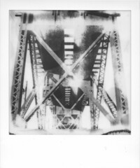 Something There. (artwpn) Tags: philadelphia polaroid sx70 blackwhite outdoor traintracks trains oldbuildings instant westphilly universitycity landcamera instantphotography oldshit px100 impossibleproject theimpossibleproject