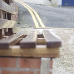 Parallel Parking Juxtaposition (Rusty Marvin - JohnWoracker.com) Tags: wood blue brick lines tarmac yellow bench concrete seat parking isleofwight juxtaposition parallel wight bembridge