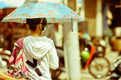 Hot (yablinksht) Tags: street girl umbrella asia mask vietnam heat backpack saigon hochiminh