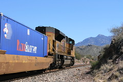 Union Pacific intermodal train (Mark Vogel) Tags: railroad bridge arizona cactus mountains up creek train desert eisenbahn railway az rivire container sp pont arid cienega montagnes intermodal chemindefer doublestacks cienegacreek union containertrain sunsetroute pacific cienga ciengacreek