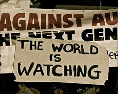 the world is watching ..... (ana_lee_smith) Tags: portrait toronto wednesday lens photography movement downtown library photojournalism police peaceful gazebo beercan yurt stjamespark civildisobedience resistance global socialdocumentary eviction kingst officers thefaceof analeesmith minoltaaf70210mm sonyalphaa33 occupytoronto occupyingtoronto nov23rd2011 metropolitantorontopoliceforce