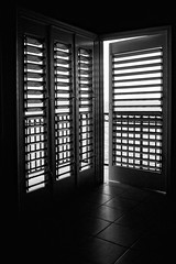 1.) Shadow and Light (Canadapt) Tags: ocean door light shadow abstract silhouette graphic jamaica shutter blinds caribbean canadapt bestcapturesaoi