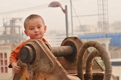 The Destruction of Kashgar, #6 (**El-Len**) Tags: centralasia eastturkestan china xinjiang kashgar kashi child boy portrait machinery fav10 thegalleryoffinephotography earthasia