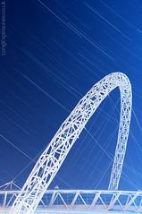 Arch Rivals (AndWhyNot) Tags: longexposure urban london night stars football long exposure arch stadium curve fa equator celestial startrails wembley lightpollution