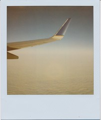 Plane ride. (N.Misciagna) Tags: vacation sky sun slr film clouds analog plane airplane polaroid ride florida flight 600 integral instant expired 680 film""