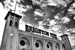 Brighton Pier (King Grecko) Tags: winter shadow sea england sky blackandwhite bw cloud seagulls white black building silhouette canon pier brighton moody britain perspective shade 7d silhoutte atmospheric ipad canon7d snapseed