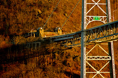 Bridge Shadows (SunnyDazzled) Tags: bridge winter light sunset red house newyork history construction highway shadows suspension landmark historic bearmountain cables anchor roadsign hudsonriver 1924 fortmontgomery