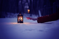 how to save a life (AmyJanelle) Tags: blue light red snow cold girl stars star warm arm bokeh grain reach lantern redcoat