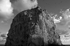 Majestic Rock Formation in Cabo San Lucas (SmittysShots) Tags: ocean sunset shadow sky blackandwhite white mountain birds rock clouds dark cabo ominous eerie formation vultures landsend majestic cabosanlucas elarco