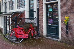 Fiets - Bike (RuudMorijn) Tags: street door old travel red summer people urban house holland color detail brick heritage monument water netherlands dutch amsterdam bike bicycle yellow metal stone closeup stairs composition vintage cycling design canal ancient colorful europe european exterior view exercise tulips painted traditional famous capital transport style structure cobblestones 99 cycle biking winkel historical quilts typical patchwork striking rood nederlands oud pedal voorburg wal fiets tulpen rode gele pand nieuwezijds typisch grachtenpand monumentaal strikingly