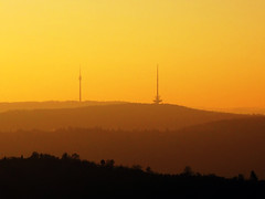 TV Tower and Mountains in November Sunset (Batikart) Tags: park autumn sunset sky orange brown mountain black color colour tree tower art fall nature berg silhouette yellow backlight forest canon germany season landscape geotagged deutschland flora europa europe stu
