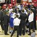 Mike Krzyzewski coachs team during timeout.