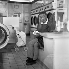 In the Laundromat (ted.kozak) Tags: bw woman london 120 6x6 film window mediumformat square portait rodinal laundromat selfdeveloped kozak bronicasqa zenzanonps80mmf28 tedkozak bwfujineopan400 tadaskazakevicius