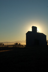 Farm Sunset (albinobobman) Tags: sunset mountains field silhouette barn colorado farm