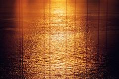 The Golden Gate (Leighton Wallis) Tags: sanfrancisco california birthday ca usa sun reflection water silhouette sunrise dawn bay suspension unitedstatesofamerica goldengatebridge ripples 75thanniversary ggnpc11