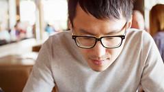 Daniel, menu pondering (Eric Flexyourhead (Onoharahigashi)) Tags: portrait canada man guy vancouver restaurant glasses pub friend photographe