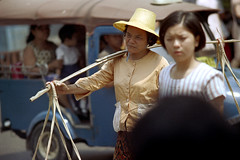 19-623 (ndpa / s. lundeen, archivist) Tags: city people woman color film hat truck 35mm thailand women bangkok candid nick citylife streetphotography streetlife passengers thai vehicle 1970s 1972 19 1973 carry strawhat carrying dewolf yoke nickdewolf photographbynickdewolf reel19