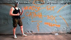 propaganda or vandalism? (nyet, avant-garde) (LittleBigBatman) Tags: street streetart art underground crazy gun mask god russia moscow jesus skills nike camo russian avantgarde orthodoxy      awsm
