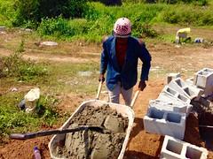 Day Laborer at Juju Films Studios construction site in Ushafa Village (Jujufilms) Tags: poverty africa travel people photography cement photojournalism buildingblocks socialmedia abuja africanculture daylaborer ayotunde jujufilms jujufilmstv nigerianstreetauthor ogbeniayotunde ushafavillage gbagyi wheelborough