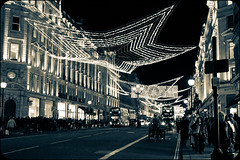 Xmas Lights, Regents St London (fotosiris) Tags: christmas street xmas uk decorations england bus london canon eos lights britain cab kitlens regents 550d