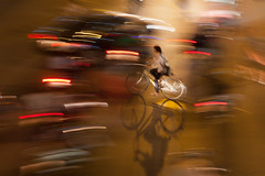 Cyclist (peterderooij) Tags: street longexposure shadow motion blur bicycle night lights movement asia traffic vietnam hanoi panning sodium vitnam hni