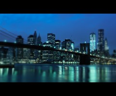 Lens Blur over Cloudy Lower Manhattan [blue_tone] (Yohsuke_NIKON_Japan) Tags: christmas nyc blue winter usa ny newyork blur reflection water river nikon december bokeh dumbo brooklynbridge eastriver wallstreet  zoomlens   12 lensblur 18200mm  colorefex architecture  1wtc     d3100