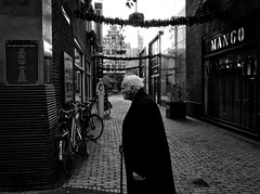 The City XXI (Daan L) Tags: street old city urban white man black holland monochrome digital walking mono noir 4 january nederland center walkingstick elderly stick metropolis gr zwart wit iv blanc centrum ricoh stad 2012 straat 070 venestraat januarie dutch thenetherlands thehague denhaag lahaye richohgrdigitaliv