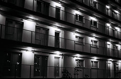 Flats (Phil Gyford) Tags: uk london night buildings apartments dcc flats hackney greenway hackneywick mycooljeans wicklane film:iso=400 film:brand=kodak camera:make=pentax lens:make=pentax lens:focal_length=50mm camera:model=k1000 film:name=kodaktrix lens:lenstag=pentax50mmf17 lens:min_aperture=f17 filmnumber99 trizers
