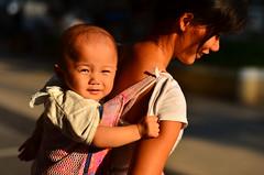 A bond eternal (A. adnan) Tags: guangzhou china street light sun love beautiful sunshine nikon child affection mother son parent guangdong bond motherhood nikon50mmf14d sooc bangladeshiphotographer d7000