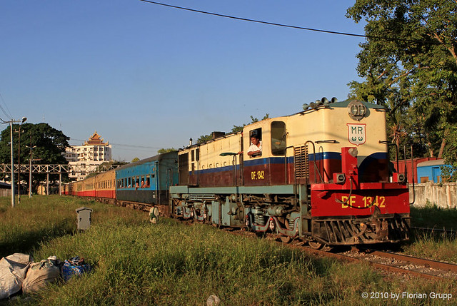 Express train to Myitkyina pulled by DF1342 leaving Mandalay station