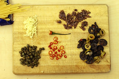 Puttanesca (Luke_23) Tags: food canon 50mm pasta anchovies meal 7d olives garlic spaghetti chilli linguine capers anchovy birdseye choppingboard chillie puttanesca