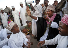 Praying And Singing With Young Boys At Maulidi Festival Celebration, Lamu, Kenya (Eric Lafforgue) Tags: africa music color hat horizontal children outdoors island drums photography kid exterior child kenya drum muslim islam culture unescoworldheritagesite gathering drummer afrika tradition lamu kneeling speaking cultural megaphone swahili afrique eastafrica menonly mawlid baraza qunia kofia largegroupofpeople lamuisland lafforgue traveldestination percussioninstrument africanethnicity kanzu manonly  qunia    kea 126501   tradingroute 910years 78years blackethnicity birthoftheprophet a maulidifestival