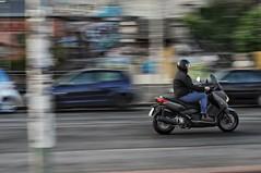 Speeding out of frame (Bilderwense) Tags: street speed wow germany 50mm hamburg streetphotography scooter motorbike roller nikkor50mmf18 nikkor f18 panning tempo speeding rasen motocycle motorrad schnell geschwindigkeit freigestellt d5000 nikond5000 hamsestadt