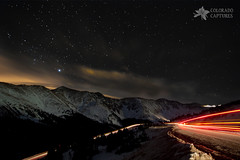 Headlights And Taillights Under The Stars (Mike Berenson - Colorado Captures) Tags: longexposure sky mountain mountains cold nature water weather night stars colorado headlights alpine rockymountains lighttrails cupid taillights allrightsreserved lovelandpass summitcounty continentaldivide lightpollution arapahoebasin grizzlypeak blendedexposures deepskystacker coloradocaptures copyright2011bymikeberenson