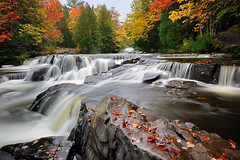 """Autumns Art"" - Bond Falls - Paulding, Michigan (Michigan Nut) Tags: longexposure autumn red orange usa color fall nature leaves yellow america creek forest river geotagged waterfall leaf woods midwest stream michigan peninsula cascade bondfalls"