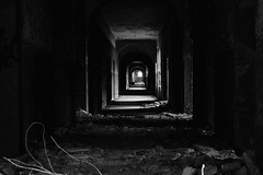 The Hallway (Jonathan Adami) Tags: longexposure light blackandwhite bw berlin abandoned night hospital germany sony hallway lowkey urbex nex underexposure 18200mm beelitz heilstatten nex5 sel18200