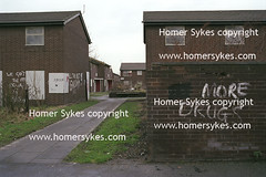 Run down council housing estate No More Drugs, Moss Side Near Manchester, England. (Homer Sykes) Tags: poverty uk england house english home manchester graffiti estate britain terrace 1993 council british 1990s 90s rundown gbr terraced socialhousing mossside nomoredrugs archivestock