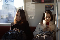 Two Ladies on the Keikyu Line train, Tokyo (Alfie | Japanorama) Tags: winter ladies cute japan lady train japanese tokyo women pretty afternoon candid rangefinder epson rd1 canon35mmf2rf