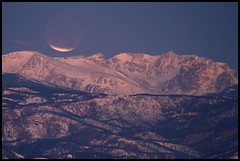 Eclipse (gainesp2003) Tags: moon mountains eclipse colorado indian rocky co astronomy peaks lunar moonset dec102011