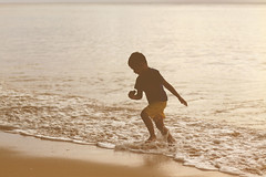 Joy is... (315Edith) Tags: boy sea beach silhouette 50mm seaside waves afternoon child frolic catanduanes dondi 500d