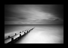 Calm before the storm (Dom's Photography) Tags: sea seascape storm beach water clouds pier long exposure milky groyne