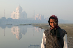 Taj Mahal, Agra, India (Jitendra Singh : Indian Travel Photographer) Tags: morning winter sky blackandwhite cloud india colour reflection tree history monument water weather horizontal fog architecture square outdoors photography dawn vanishingpoint haze memorial asia day arch minaret tomb crowd tajmahal agra nopeople palace unescoworldheritagesite mausoleum dome marble oniondome thepast treelined in formalgarden mughal uttarpradesh traveldestinations buildingexterior placeofinterest internationallandmark largegroupofpeople indiansubcontinent mughalempire builtstructure traditionallyindian incidentalpeople