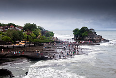 tourists (Josh RCG) Tags: ocean sea people bali cloud tourism beach water rock clouds indonesia island temple rocks village lot overcast hindu tanahlot tanah