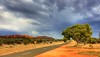 Road into the Storm (AdamNoosa) Tags: road trees red storm west tree adam grass rain clouds gum drive rocks alice australia soil ranges springs outback dust northern tar gormley territory floodway macdonnell larapinta
